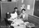 Bill Morita and Nab Otomori sitting in a Heart Mountain High School classroom, 1944.